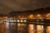 PARIS-JANUARY 9: The Seine river bank at Christmas at night on January 9,2012 in Paris. — Stock Photo