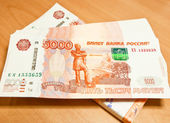 Russian five thousand rubles banknotes at the wood background. — Stock Photo