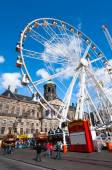 AMSTERDAM-APRIL 27: Dam Square and Royal Palace on the background during King's Day on April 27, 2015 in Amsterdam, Netherlands. — Stock Photo