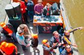 AMSTERDAM,NETHERLANDS-APRIL 27: Boat party with DJ on a boat, Amsterdam canal during King's Day on April 27,2015. — Stock Photo