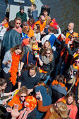 AMSTERDAM,NETHERLANDS-APRIL 27: People on Party Boat celebrate King's Day on April 27,2015, the Netherlands. — Fotografia Stock