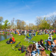 Постер, плакат: AMSTERDAM APRIL 27: Locals and tourists in orange celebrate Kings Day in on April 27 2015 in Vondelpark