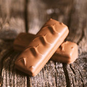 Chocolate bar with caramel and coffee filling — Stock Photo