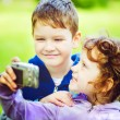 Happy little boy and girl taking self photo in the autumn park. — Stock Photo #52676251