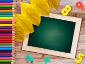"Blackboard the words ""Back to School"" lie on a wooden table wit — Stock Photo"