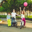 Children on bicycle in the park,  background toning for instagra — Stock Photo #73413433