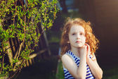 Dreamy little girl in the spring park, , background toning for i — Stock Photo