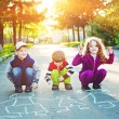 Child draws on asphalt. — Stock Photo #77338202