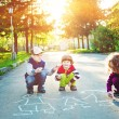 Child draws on asphalt. — Stock Photo #77338212