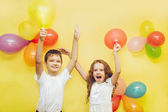 Happy children with balloons at happy birthday party. — Stock Photo
