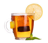 Glass cup of tea with lemon and mint isolated on white backgroun — Stock Photo