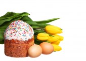 Easter cake and eggs with flowers isolated on white background. — Stock Photo