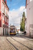 Traditional yellow tram in Alfama. — Stock Photo