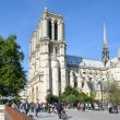Tourists walking in front of Notre Dame Cathedral. — Stock Photo #56132669