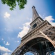 Eiffel Tower against blue cloudy sky. — Stock Photo #56136307