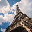 Eiffel Tower isolated against blue cloudy sky. — Stock Photo #56152639