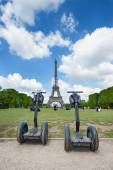 Segway parked in front the Eiffel Tower in Paris — Stock Photo