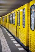 Yellow metro in subway station. — Stock Photo