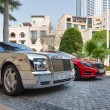 Постер, плакат: Luxury car parked outside Palace Hotel