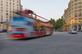Touristic bus in the street of the city. — Foto de Stock