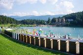Tourists enjoying Lavarone Lake on a sunny day. — Stock Photo