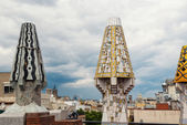 Colourful chimneys on rooftop of Gaudi's masterpiece — Stockfoto