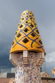 Colourful chimney on rooftop of  Gaudi's masterpiece — Stock Photo
