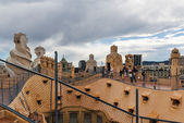 Tourists on rooftop of Gaudi's  masterpiece — Stock Photo