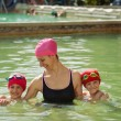 Mother and sons in thermal swimming pool. — Stock Photo #56618437