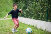 Young kid playing soccer. — Stock Photo