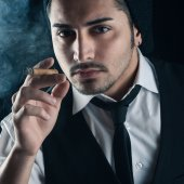 Young man close up portrait with cigar — Stock Photo