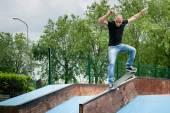 Skateboarder doing a skateboard trick at skatepark. — Stock Photo