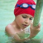 Kid in thermal swimming pool. — Stock Photo #56634961
