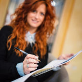 Girl with open writing on copybook — Stock Photo