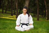 Young woman practicing judo portrait — Stock Photo