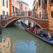Tourists enjoying a tour on gondola in Venice. — 图库照片 #57379039