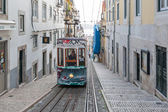 Traditional funicular in narrow street. — Stock Photo