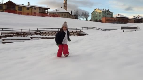Young girl running on snow — Vidéo