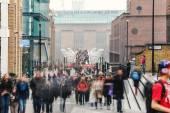 People walking over Millennium bridge — Stock Photo