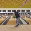 Young kid playing bowling — Stock Video #68583911