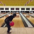 Kid throwing bowling ball down — Stock Video #68584137