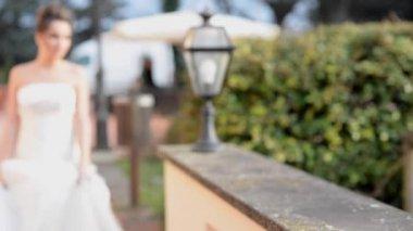 Smiling bride walking in park — Stock video