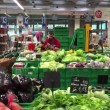 Worker preparing vegetables inside Coop Supermarket — Stock Video #69221579