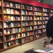 People walking inside Coop Supermarket bookstore — Stock Video #69223513