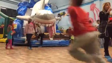 Kids playing with inflatable shark — Stock Video