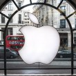 Постер, плакат: Apple logo displayed on window of Apple Store