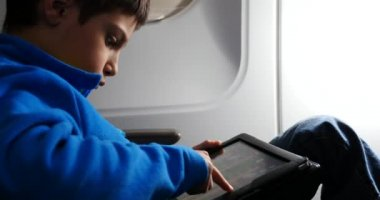 Kid relaxing using tablet — Stock Video