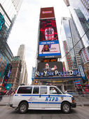 NYPD van and sign at Times Square in New York — Stock Photo