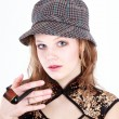Lady wearing a hat and holding a smoking pipe — Stock Photo #65582131