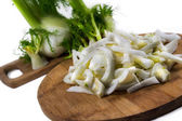 Fresh, organic slices of  fennel on a wooden board  — Stock Photo
